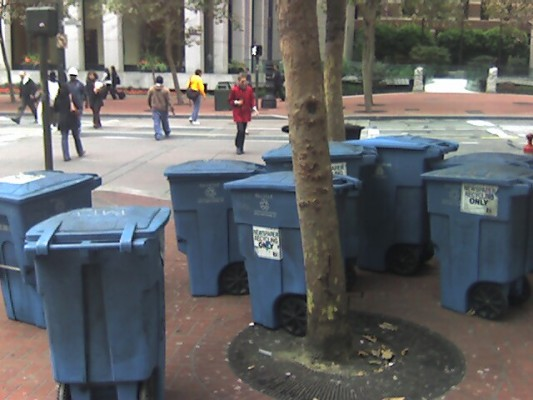a herd of recycling bins